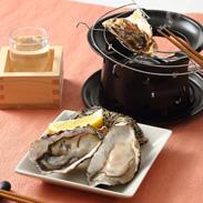 養殖業者だからお届けできる美味しさ! 『殻付き牡蠣[加熱用]』と『かき燻製』セット   有限会社尾崎・広島県