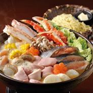 石狩鍋(4〜5人前)セット〔ゆでたらばがに脚、秋鮭切身×4、ゆで帆立、秋鮭白子、秋鮭アラ、バター×3、カットコーン×4、いももち×8、ラーメン、鍋用味噌×5〕